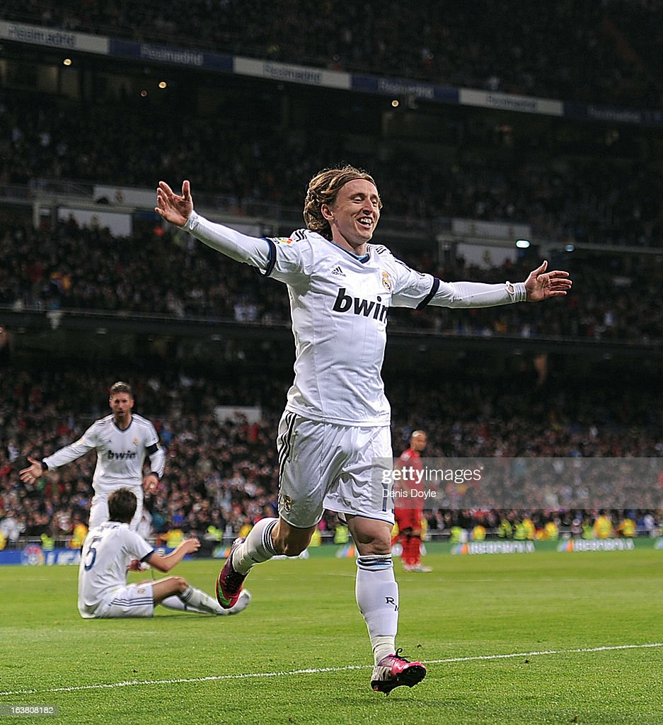 <a gi-track='captionPersonalityLinkClicked' href=/galleries/search?phrase=Luka+Modric&family=editorial&specificpeople=560350 ng-click='$event.stopPropagation()'>Luka Modric</a> of Real Madrid CF celebrates after scoring Real's 3rd goal during the La Liga match between Real Madrid CF and RCD Mallorca at estadio Santiago Bernabeu on March 16, 2013 in Madrid, Spain.