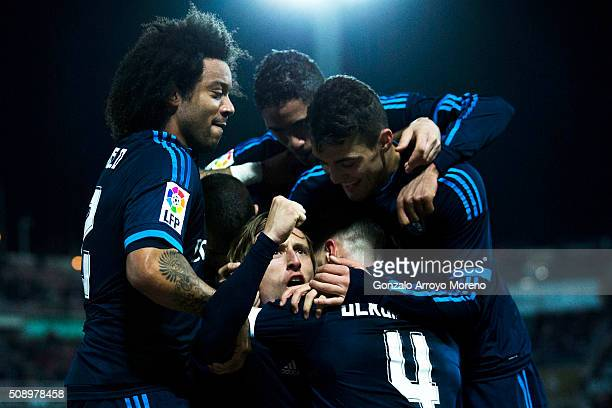 Luka Modric of Real Madrid CF celebrates scoring their second goal with teammates Marcelo Raphael Varane and Mateo Kovacic during the La Liga match...