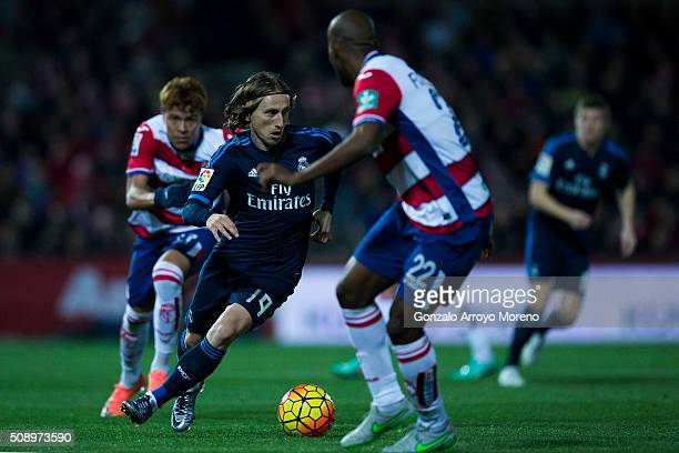 Luka Modric of Real Madrid CF competes for the ball with Dimitri Foulquier of Granada CF during the La Liga match between Granada CF and Real Madrid...