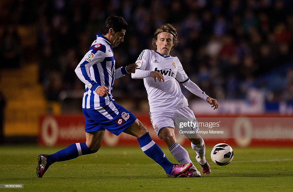 <a gi-track='captionPersonalityLinkClicked' href=/galleries/search?phrase=Luka+Modric&family=editorial&specificpeople=560350 ng-click='$event.stopPropagation()'>Luka Modric</a> (R) of Real Madrid CF competes for the ball with Ivan Sanchez Rico alias Riki (L)of RC Deportivo La Coruna during the La Liga match between RC Deportivo La Coruna and Real Madrid CF at Riazor Stadium on February 23, 2013 in La Coruna, Spain.