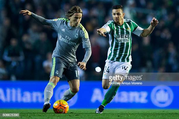 Luka Modric of Real Madrid CF competes for the ball with Ruben Castro of Real Madrid CF during the La Liga match between Real Betis Balompie and Real...