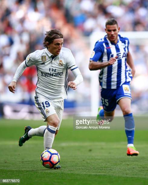 Luka Modric of Real Madrid CF competes for the ball with Theo Hernandez of Deportivo Alaves during the La Liga match between Real Madrid CF and...