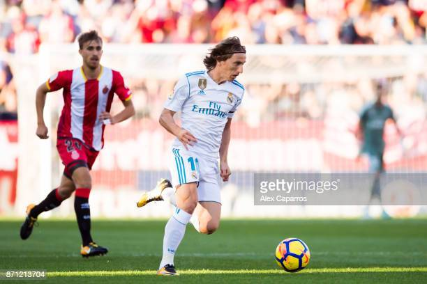 Luka Modric of Real Madrid CF conducts the ball during the La Liga match between Girona and Real Madrid at Estadi de Montilivi on October 29 2017 in...