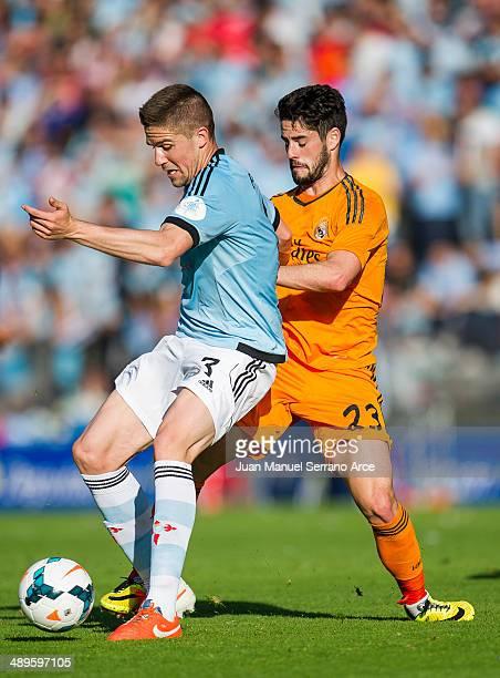 Luka Modric of Real Madrid CF duels for the ball with Andreu Fontas of RC Celta De Vigo during the la Liga match between Real Club Celta De Vigo and...