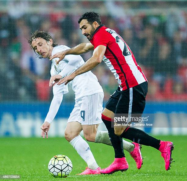 Luka Modric of Real Madrid CF duels for the ball with Mikel Balenziaga of Athletic Club Bilbao during the La Liga match between Athletic Club Bilbao...