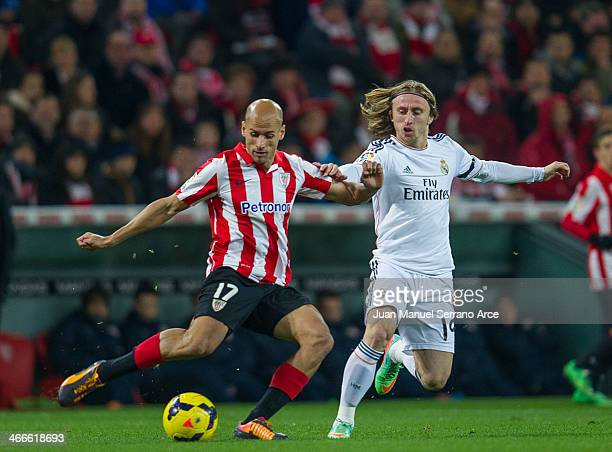 Luka Modric of Real Madrid CF duels for the ball with Mikel Rico of Athletic Club Bilbao during the La Liga match between Athletic Club Bilbao and...