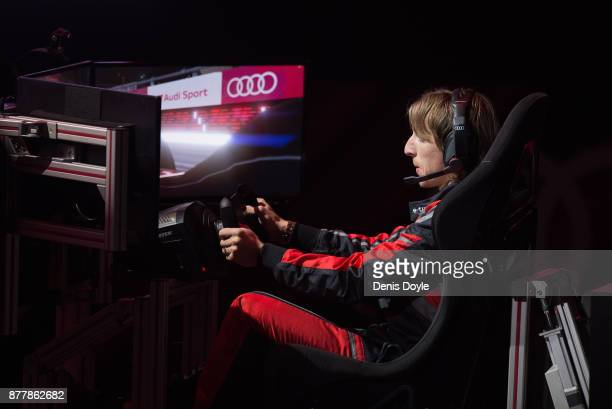 Luka Modric of Real Madrid CF races in his simulated Formulae car during a race with his teammates during the Audi Handover Sponsorship deal with...
