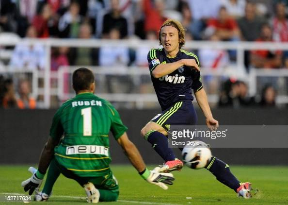 Luka Modric of Real Madrid CF tries to shoot past Dani Gimenez of Rayo Vallecano de Madrid during the La Liga match between Rayo Vallecano de Madrid...