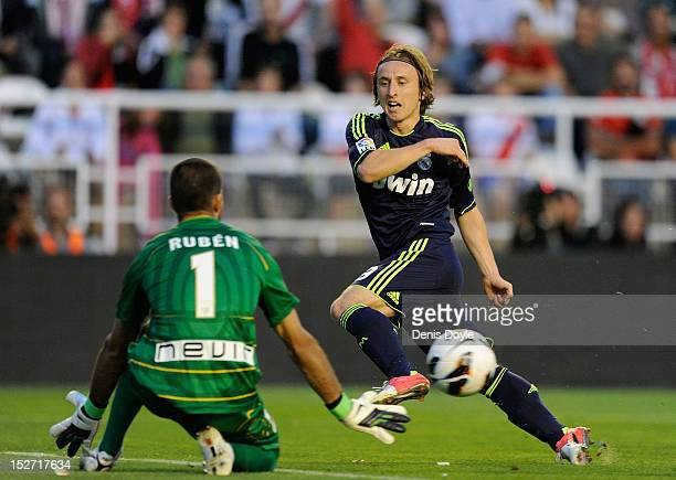 Luka Modric of Real Madrid CF tries to shoot past Dani Gimenez of Rayo Vallecano de Madrid during the La Liga match between Rayo Vallecano de Madrid...