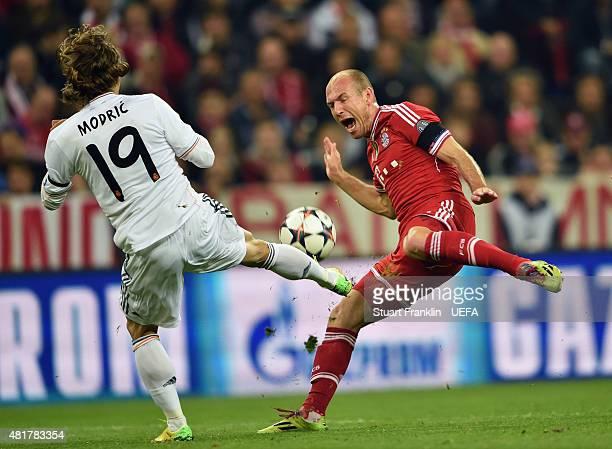 Luka Modric of Real Madrid challenges Arjen Robben of Bayern Munich during the UEFA Champions League Semi Final second leg match between FC Bayern...