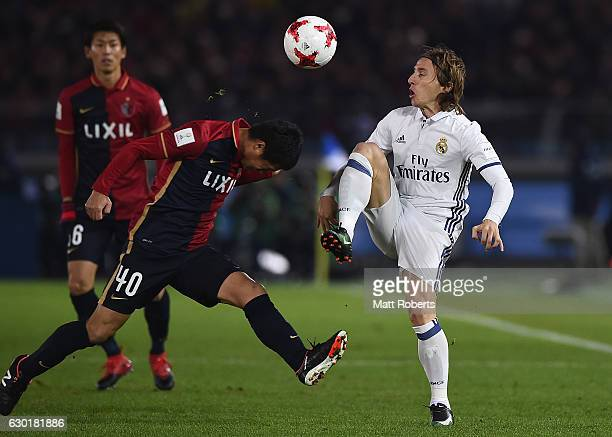 Luka Modric of Real Madrid competes for the ball against Mitsuo Ogasawara during the FIFA Club World Cup final match between Real Madrid and Kashima...
