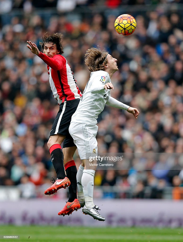 <a gi-track='captionPersonalityLinkClicked' href=/galleries/search?phrase=Luka+Modric&family=editorial&specificpeople=560350 ng-click='$event.stopPropagation()'>Luka Modric</a> (R) of Real Madrid competes for the ball with <a gi-track='captionPersonalityLinkClicked' href=/galleries/search?phrase=Ander+Iturraspe&family=editorial&specificpeople=6331918 ng-click='$event.stopPropagation()'>Ander Iturraspe</a> of Athletic Club during the La Liga match between Real Madrid CF and Athletic Club at Estadio Santiago Bernabeu on February 13, 2016 in Madrid, Spain.