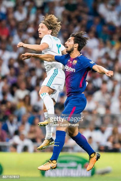MADRID SPAIN AUGUST 16 Luka Modric of Real Madrid competes for the ball with Andre Filipe Tavares Gomes of FC Barcelona during their Supercopa de...