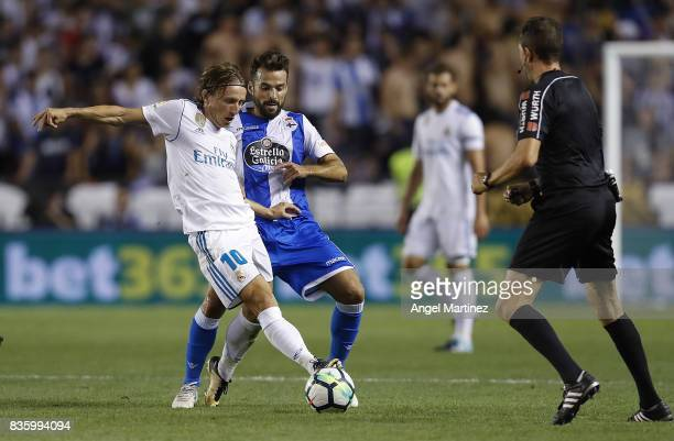 Luka Modric of Real Madrid competes for the ball with Bruno Gama of Deportivo La Coruna during the La Liga match between Deportivo La Coruna and Real...