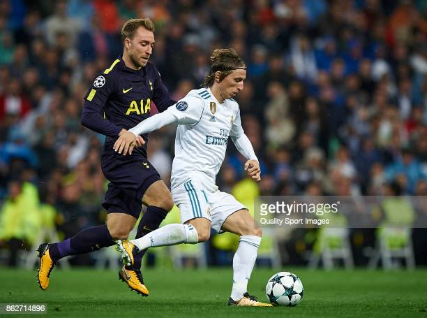 Luka Modric of Real Madrid competes for the ball with Christian Eriksen of Tottenham Hotspur during the UEFA Champions League group H match between...