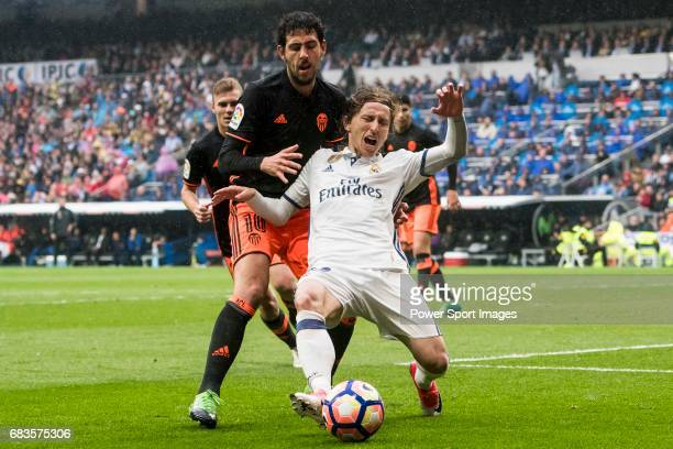 Luka Modric of Real Madrid competes for the ball with Daniel Parejo Munoz of Valencia CF during their La Liga match between Real Madrid and Valencia...
