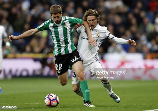 Luka Modric of Real Madrid competes for the ball with Darko Brasanac of Real Betis during the La Liga match between Real Madrid and Real Betis...