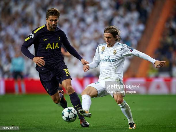Luka Modric of Real Madrid competes for the ball with Fernando Llorente of Tottenham Hotspur during the UEFA Champions League group H match between...