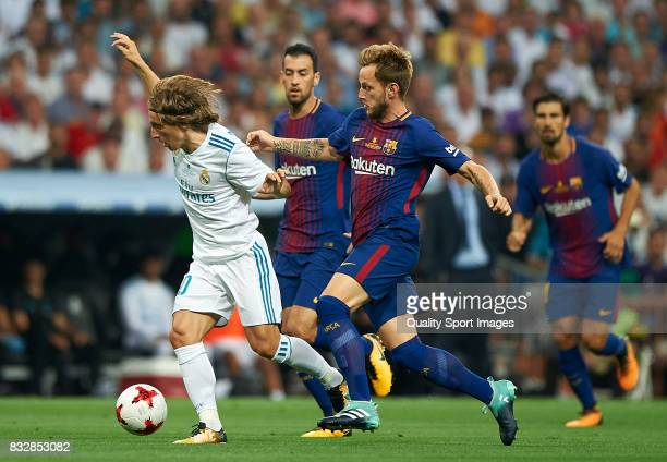 Luka Modric of Real Madrid competes for the ball with Ivan Rakitic of Barcelona during the Supercopa de Espana Supercopa Final 2nd Leg match between...