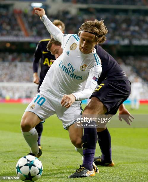 Luka Modric of Real Madrid competes for the ball with Jan Vertonghen of Tottenham Hotspur during the UEFA Champions League group H match between Real...