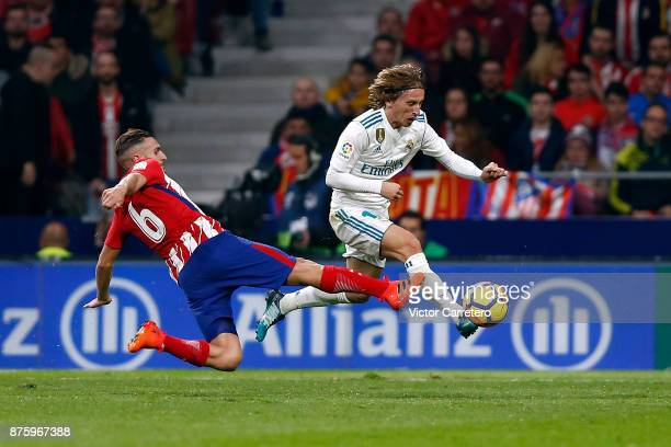 Luka Modric of Real Madrid competes for the ball with Koke of Atletico Madrid during the La Liga match between Atletico Madrid and Real Madrid at...