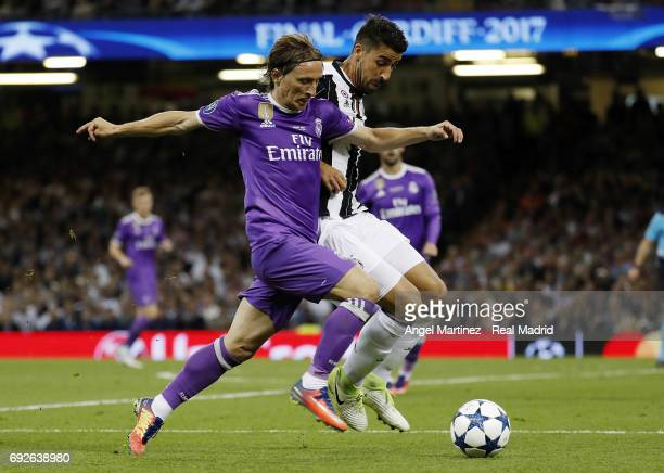 Luka Modric of Real Madrid competes for the ball with Sami Khedira of Juventus during the UEFA Champions League Final match between Juventus and Real...
