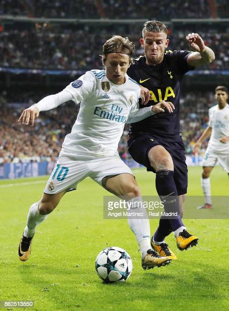 Luka Modric of Real Madrid competes for the ball with Toby Alderweireld of Tottenham Hotspur during the UEFA Champions League group H match between...