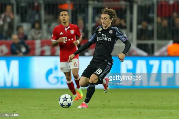 Luka Modric of Real Madrid controls the ball during the UEFA Champions League Quarter Final first leg match between FC Bayern Muenchen and Real...