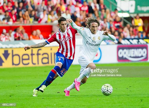 Luka Modric of Real Madrid duels for the ball with Arnaldo Sanabria of Real Sporting de Gijon during the La Liga match between Sporting Gijon and...