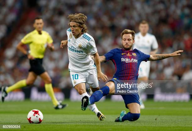 Luka Modric of Real Madrid duels for the ball with Ivan Rakitic of FC Barcelona during the Supercopa de Espana Final second leg match between Real...