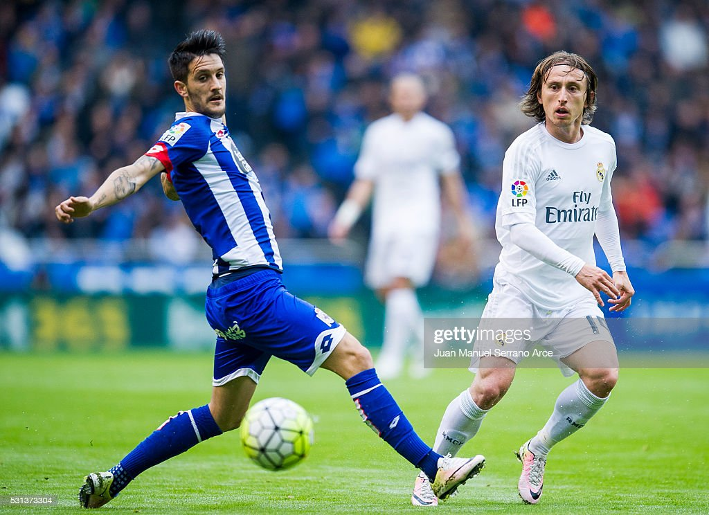 Luka Modric of Real Madrid duels for the ball with Luis Alberto Romero of RC Deportivo La Coruna during the La Liga match between RC Deportivo La Coruna and Real Madrid CF at Riazor Stadium on May 14, 2016 in La Coruna, Spain.