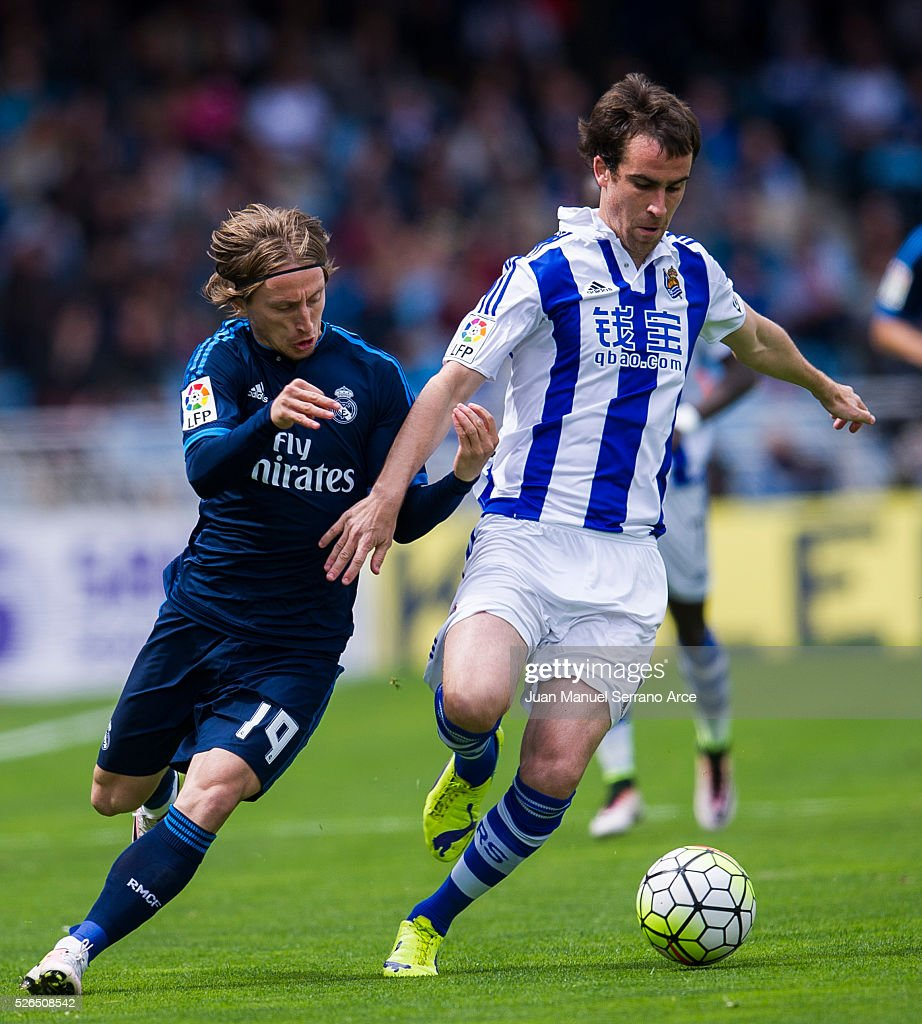 Luka Modric of Real Madrid duels for the ball with Mikel Gonzalez of Real Sociedad during the La Liga match between Real Sociedad de Futbol and Real Madrid at Estadio Anoeta on April 30, 2016 in San Sebastian, Spain.