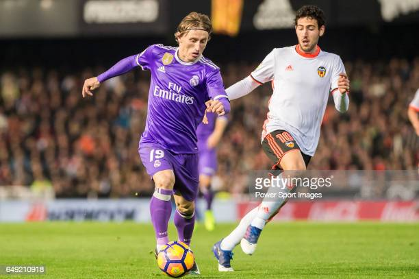 Luka Modric of Real Madrid fights for the ball with Daniel Parejo Munoz of Valencia CF during their La Liga match between Valencia CF and Real Madrid...