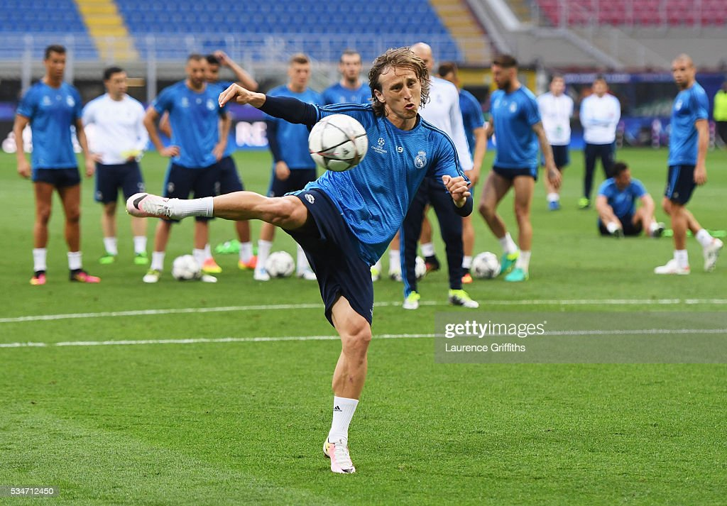 <a gi-track='captionPersonalityLinkClicked' href=/galleries/search?phrase=Luka+Modric&family=editorial&specificpeople=560350 ng-click='$event.stopPropagation()'>Luka Modric</a> of Real Madrid has a shot on goal during a Real Madrid training session on the eve of the UEFA Champions League Final against Atletico de Madrid at Stadio Giuseppe Meazza on May 27, 2016 in Milan, Italy.