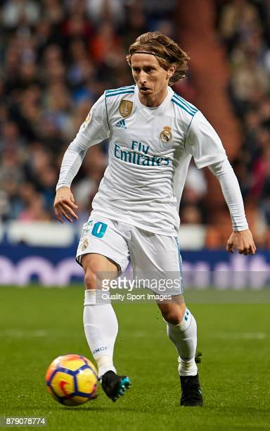 Luka Modric of Real Madrid in action during the La Liga match between Real Madrid and Malaga at Estadio Santiago Bernabeu on November 25 2017 in...