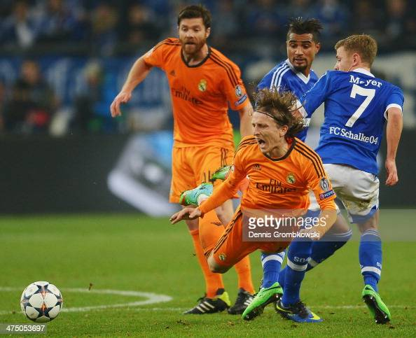 Luka Modric of Real Madrid is challenged by Max Meyer of FC Schalke 04 during the UEFA Champions League Round of 16 first leg match between Schalke...