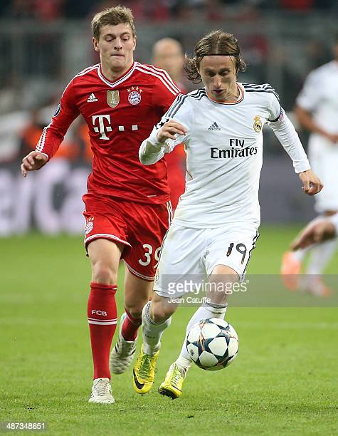 Luka Modric of Real Madrid is chased by Toni Kroos of Bayern Muenchen during the UEFA Champions League semifinal second leg match between FC Bayern...