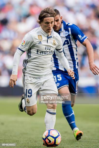 Luka Modric of Real Madrid is followed by Bernard Francois Hernandez Pi Theo Hernandez of Deportivo Alaves during their La Liga match between Real...