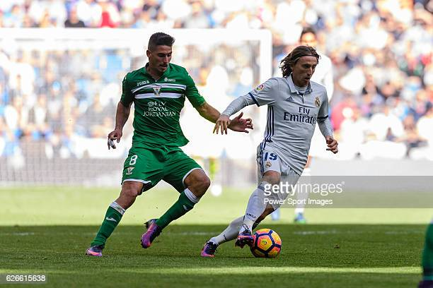 Luka Modric of Real Madrid is followed by Gabriel Appelt Pires of Deportivo Leganes during their La Liga match between Real Madrid and Deportivo...