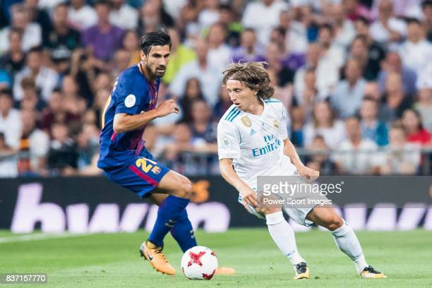MADRID SPAIN AUGUST 16 Luka Modric of Real Madrid is tackled by Andre Filipe Tavares Gomes of FC Barcelona during their Supercopa de Espana Final 2nd...