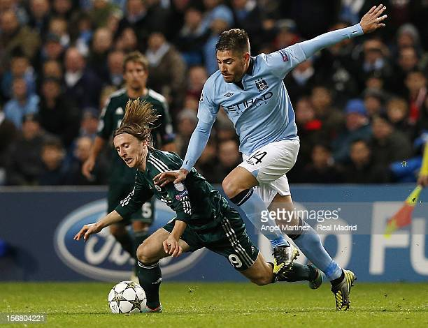 Luka Modric of Real Madrid is tackled by Javier Garcia of Manchester City during the UEFA Champions League Group D match between Manchester City FC...