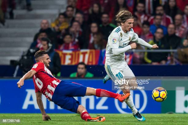 Luka Modric of Real Madrid is tackled by Jorge Resurreccion Merodio Koke of Atletico de Madrid during the La Liga 201718 match between Atletico de...