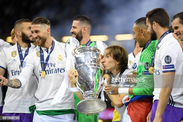 Luka Modric of Real Madrid kisses the trophy after the UEFA Champions League Final between Juventus and Real Madrid at National Stadium of Wales on...