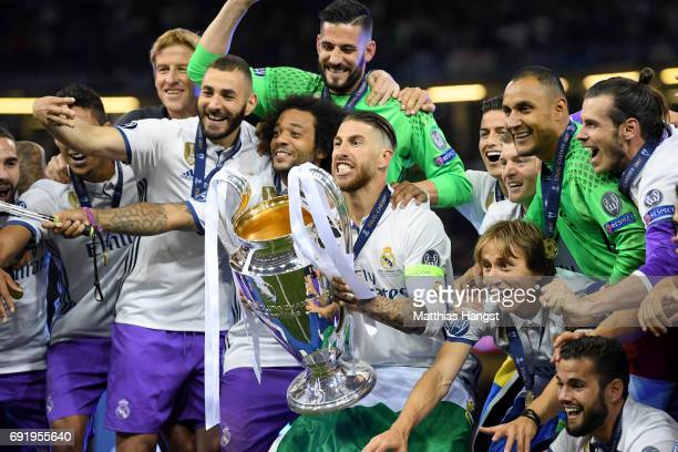 Luka Modric of Real Madrid lifts The Champions League trophy after the UEFA Champions League Final between Juventus and Real Madrid at National...