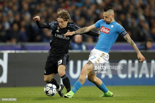 Luka Modric of Real Madrid Marek Hamsik of SSC Napoliduring the UEFA Champions League round of 16 match between SSC Napoli and Real Madrid on March...