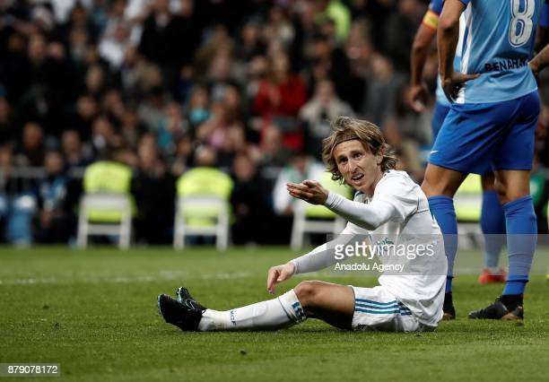 Luka Modric of Real Madrid reacts after a tackle during the La Liga match between Real Madrid and Malaga at Santiago Bernabeu in Madrid Spain on...