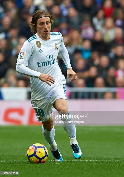 Luka Modric of Real Madrid runs with the ball during the La Liga match between Real Madrid and Sevilla at Estadio Santiago Bernabeu on December 9...