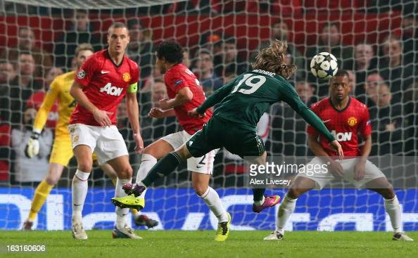 Luka Modric of Real Madrid scores his team's first goal during the UEFA Champions League Round of 16 Second leg match between Manchester United and...
