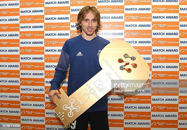 Luka Modric of Real Madrid stands with the man of the match award during the FIFA Club World Cup Semi Final match between Club America and Real...