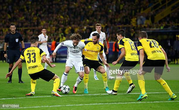 Luka Modric of Real Madrid takes on the Borussia Dortmund defence during the UEFA Champions League Group F match between Borussia Dortmund and Real...